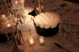 wedding-reception-table-number-and-round-white-rose-centerpiece