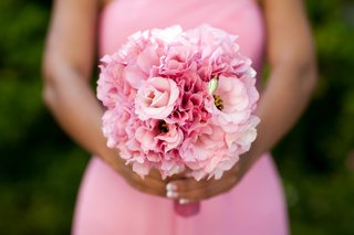 african-american-bridesmaid-holding-light-pink-wedding-bouquet