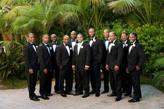 groom-with-ten-groomsmen-in-tuxedos-in-california