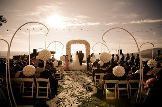 white-rose-ceremony-decorations-for-sunset-oceanview-wedding