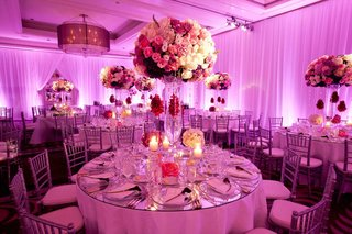 ballroom-wedding-with-hot-pink-lighting-and-large-flower-arrangements