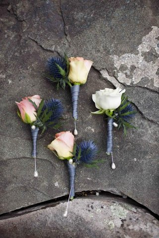 white-and-pink-roses-and-blue-thistles-for-groom