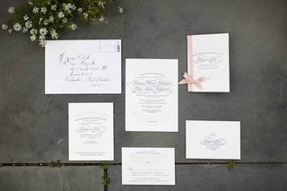 wedding-invitations-with-calligraphy-and-ribbon