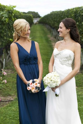 maid-of-honor-and-bride-outside-wolffer-vineyard