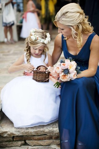 bridesmaid-sitting-with-young-girl-in-white-dress