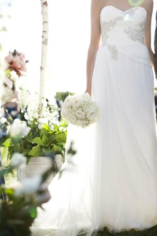 marchesa-bridal-gown-and-white-bouquet