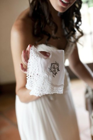 bride-holding-monogrammed-lace-doily
