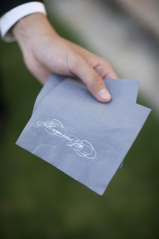 blue-napkin-with-white-calligraphy-lettering