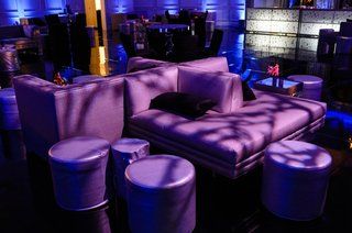 plush-furniture-and-ottomans-with-purple-lighting