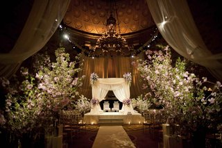 indian-hindu-wedding-ceremony-with-large-arrangements-of-greenery-and-light-purple-flowers