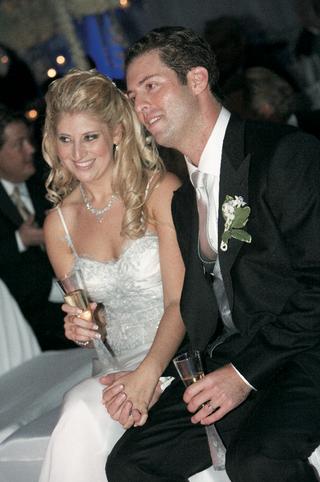 newlyweds-enjoying-reception-and-holding-hands