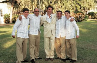 groom-with-groomsmen-in-khaki-pants-and-white-shirts