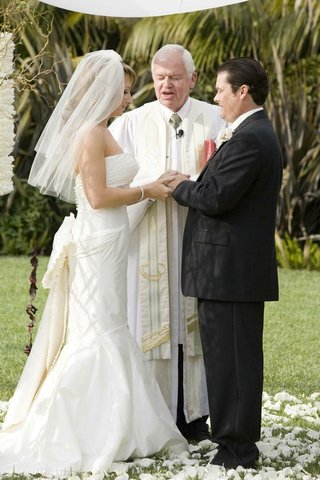 bride-and-groom-with-ceremony-officiant