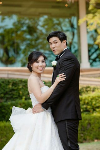 chinese-american-couple-in-wedding-dress-and-tuxedo