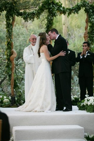 bride-and-groom-kissing-as-husband-and-wife