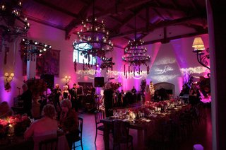 reception-room-with-chandeliers-and-vibrant-lighting