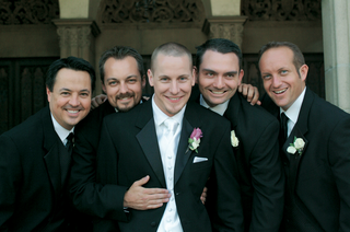 groom-with-four-groomsmen-in-black-suits