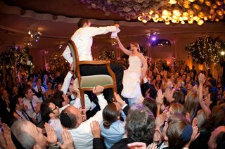 jewish-bride-and-groom-being-lifted-on-chairs