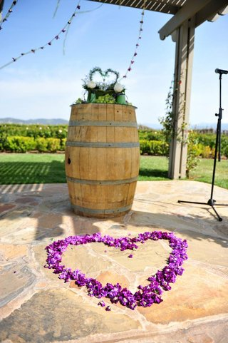 purple-flowers-in-heart-shape-at-wedding-ceremony-altar