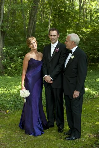 groom-with-father-and-mother-of-groom-outside