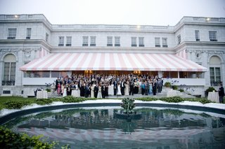 wedding-photo-outside-of-mansion-with-guests