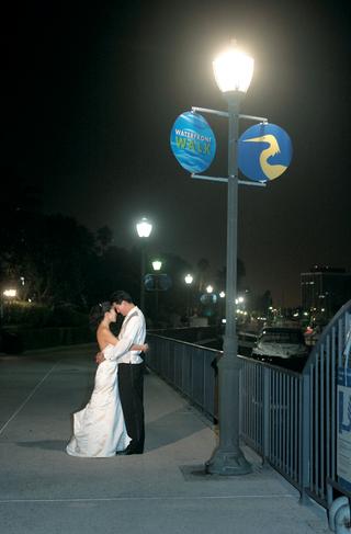 bride-and-groom-embrace-at-the-marina-at-night