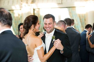 couple-dancing-at-sunlit-wedding-reception