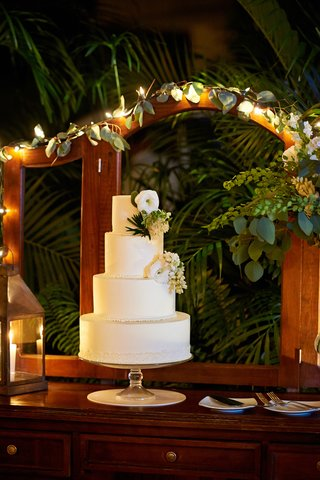 white-wedding-cake-decorated-with-greenery-and-flowers
