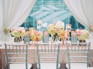 long-table-sequin-pink-champagne-colored-linen-low-pink-green-white-floral-arrangements-candles