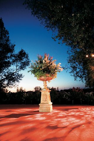 classic-stone-urn-full-of-greenery-and-flowers-for-a-wedding-reception