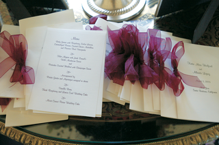 white-stationery-with-menu-selections-tied-with-purple-ribbon