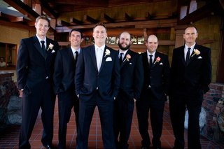 men-in-tuxedos-with-rose-boutonnieres