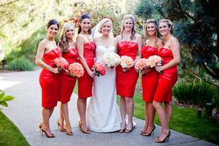 short-red-orange-bridesmaid-dresses-and-bouquets