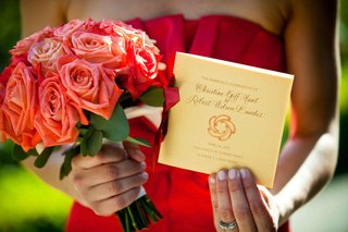 red-orange-rose-bouquet-and-ceremony-booklet