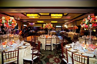 brightly-colored-floral-centerpieces-on-gold-linens