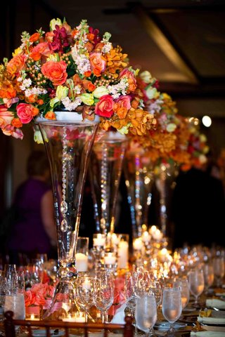 transparent-vases-topped-with-orange-flowers