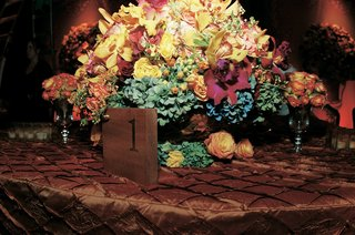 wood-wedding-table-number-and-colorful-centerpiece