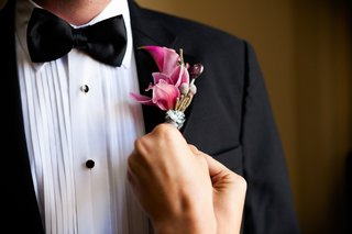tuxedo-with-bright-pink-flowers-twine-and-ribbon