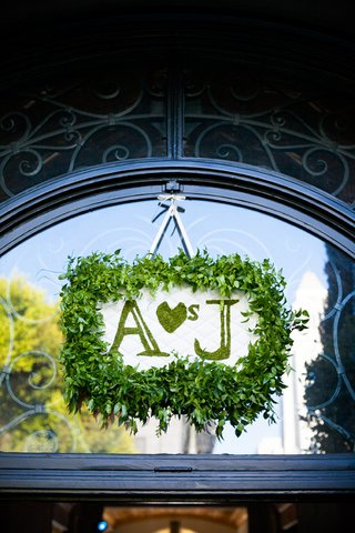 leaf-framed-white-tufted-sign-with-moss-letters