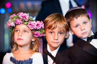 flower-girl-wearing-headpiece-and-ring-bearers-in-yamakas