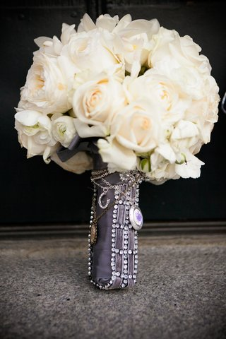 white-roses-and-flowers-wrapped-in-purple-ribbon