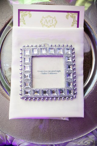 silver-charger-plate-topped-with-napkin-and-favor