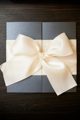 square-wedding-invite-tied-with-ivory-bow