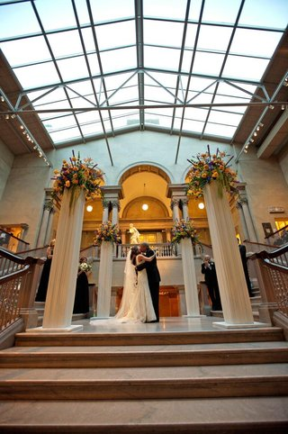 grand-staircase-with-window-ceiling-and-pillars