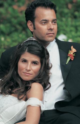close-up-newlyweds-with-orange-boutonnier