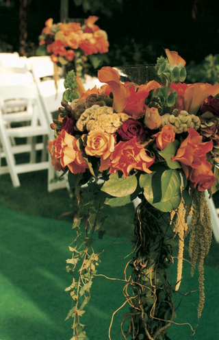 orange-flowers-and-green-leaves-decorate-ceremony-aisle