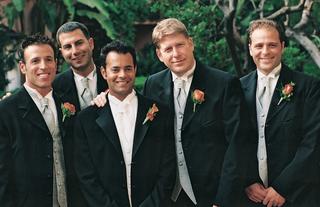 groom-and-groomsmen-wearing-blue-ties-and-vests