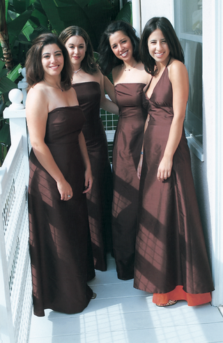 bridesmaids-wearing-long-chocolate-brown-gowns
