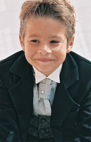 young-ring-bearer-wears-blue-tie-and-vest