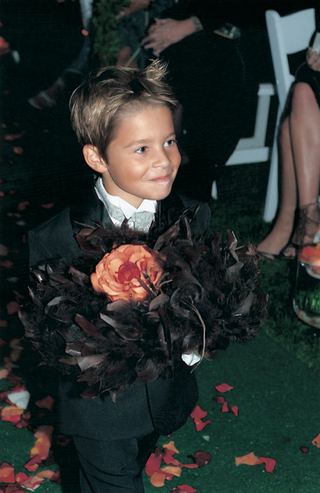 little-boy-ring-bearer-carries-rings-to-the-bride-and-groom-on-pillow